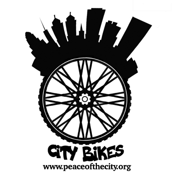 The City Bikes logo, a black and white city skyline rising from the edge of a bicycle wheel