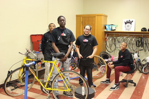 Young men working on bicycle repair and maintenance with City Bikes