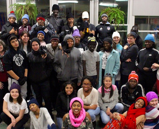 A large group of teenagers pose for a picture together at a Peace of the City Christmas event