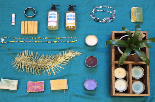 Soaps, lotions, and candles on display at the Peace of the City Basket Raffle
