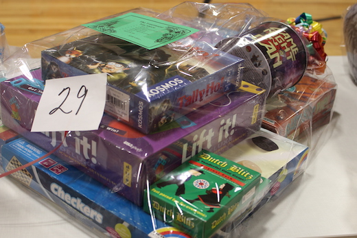 A basket of toys and board games available to win at the fundraiser