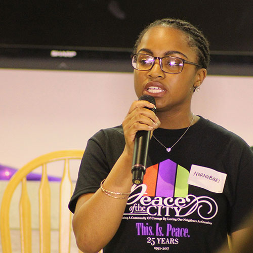 A female student performs a personal monologue for Ordinary Resurrections