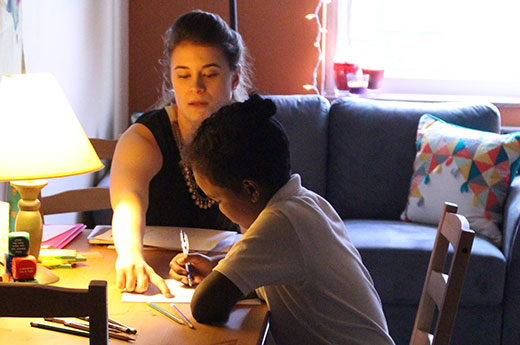 A student and tutor study together as part of Peace of the City's Literacy For All program