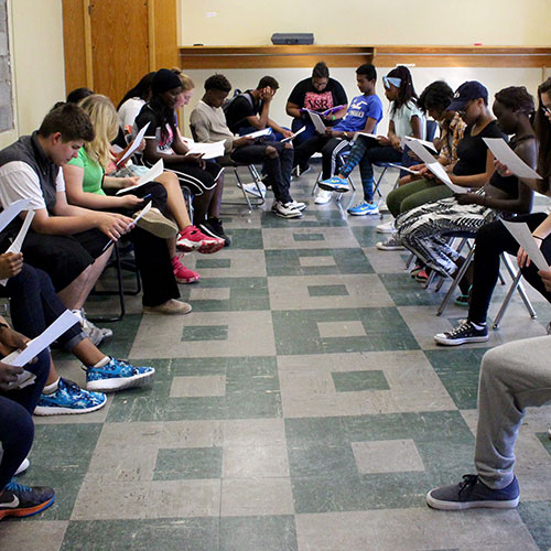 A group of students go through the first reading of their new theater scripts