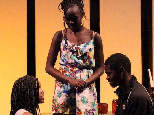 An emotional moment on stage during Romeo and Juliet, performed by students in Peace of the City's Theater for All program